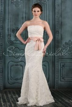 Wedding Dress by SimplyBridal. Sweet and feminine, this beautiful mermaid wedding gown is made of floor length lace. It has a lovely scallop-edged straight strapless bodice. The dress also has figure-flattering princess lines and a small brush train. The corset back and waist sash are . USD $413.99