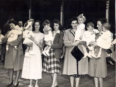 1948 - some of the participants in a baby contest held at the picnic celebrating Waterloo becoming a city. Left to right; Mrs. Margaret Steckenreiter and daughter Jeanne; Lucille Yirka and son Paul; Mrs. Robert Molson and son Bobby; Mrs. Willis Schiel and daughter Diane; Delphine Dostle and daughters Gale and Heather.