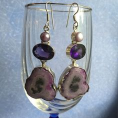 Purple Druzy/amethyst/Pearl earrings. NWOT Sterling silver with large purple agate/Druzy stone with amethyst and pearls.  Irregularities are to be expected with natural gemstones.  Somewhat heavy. Stones have natural cracks and veining. Jewelry Earrings