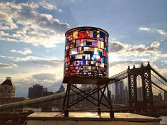 water towers | Stained-Glass Watertower is Ablaze Atop a Dumbo Warehouse