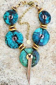 Bold and Exotic Turquoise, Gold and Copper Disc Pendant Necklace.  (If I made this I would use use silver instead of gold or brass.)