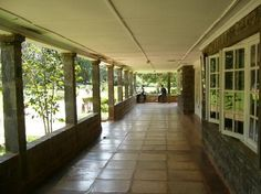 This is the veranda of the Karen Blixen House, Kenya.  I would fill it with rocking chairs.... lots and lots of rocking chairs.  And a few little tables to hold a pitcher of iced tea and a can of bug spray.  No.... wait.... there are NO flying bugs in this dream.  Only butterflies.  Pretty ones.  Not the ugly brown ones that look like moths.  And birds.  Lots of pretty birds that chirp sweetly but don't scream when I'm sleeping.