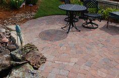 Dublin cobble paver patio with circular pattern. #TopekaLandscape