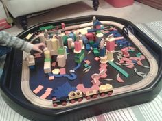 Tuff spot shape city construction with trains.