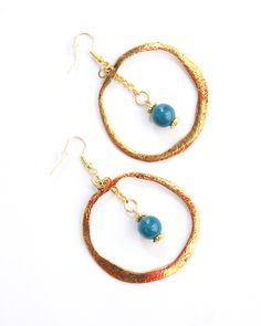 """Vi Bella Jewelry - Bonnie Blue Earrings - Gold discs and dangling blue beads are the perfect accompaniment to any outfit!       Length - 3.75""""      Handcrafted by Vi Bella Artists in Haiti.    $16.95"""