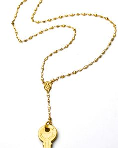 Rosary & Key mash-up necklace.  The Rosary Pendant Necklace by JewelMint.com, $54.99