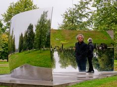 Artist Anish Kapoor is reflected in C-Curve 2007, part of the Turning the World Upside Down, four reflective stainless steel sculptures in K...