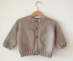 Ravelry: Project Gallery for Top Down Seamless Raglan Baby Sweater (Garter Ridge Version) pattern by Carole Barenys