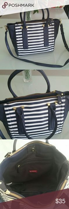 Merona bag It's in white and navy blue . Hand held and shoulder strap also . To many pockets.  Two big zippered pockets and central huge space with magnetic closure. 15 inch laptop easily accommodate. There is not any padded compartment but can be used as laptop bag . Merona Bags Laptop Bags