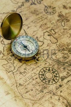 Old compass on vintage map. photo