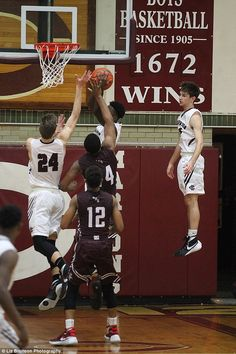 Can this kid levitate?:Walker Stillman of Champaign Central High School has been called everything from 'Float Boy' to 'Jesus' after this photo of him going for a rebound spread around social media at the weekend