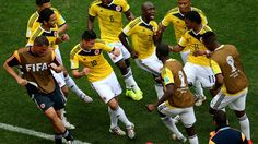 James Rodriguez #10 of Colombia celebrates by dancing with teammates