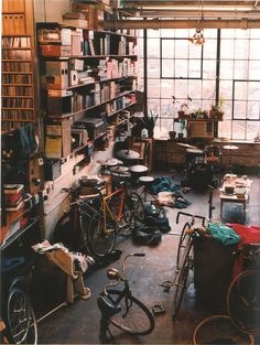 #interior with bicycles, shelves, drums