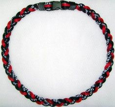 """Titanium Tornado Baseball Necklace Red Black 18"""" by Titanium Sports. $3.65. Materials emit energy that is effective in controlling the flow of bio-electric current in ones body. Improves the alignment of ions when this current is stabilized (so called """"Minus Ion Power""""), especially at the body's crucial motor joints. 3-rope design making it 3 Times more powerful than traditional single rope. Incredibly soft and comfortable"""