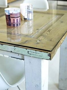 Think I found a coffee table I finally would like. A glass or plexiglass topper turns an old door into a classy coffee table or desk. I would distress the legs to match the paint on the door bottom or match them to the top. Old Door Desk, Old Door Tables, Wood Front Doors, Old Doors, Glass Table, A Table, Dinner Table, Wood Table, Furniture Projects