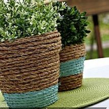 I wrapped rope around some cheap terra cotta pots and added a touch of paint…