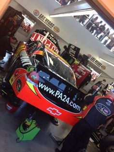 "The No. 24 team works on the DuPont ""20 Years"" Chevrolet in the Las Vegas Motor Speedway garage on March 9."