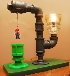 Mario Bros. Theme Industrial Pipe Lamp - This is an awesome Industrial looking lamp with some Mario thrown in. These lamps are custom made to order pieces and you can even pic different characters