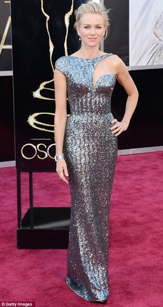 Naomi Watts in fabulous antique silver colour sequin Armani Prive. This dress fits very well and hangs beautifully. The asymmetric detail is an interesting change from standard straps and strapless and is shown off well with her soft up do.