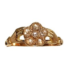 Lovely Georgian era sentimental ring. 6 rose cut diamonds form a forget-me-not flower clasped by two hands. Hands were often used in the 19th century as symbols of friendship and affection. Along with the forget-me-not flower, this ring would have been given as a token of enduring friendship and love. in 15 karat or higher gold.