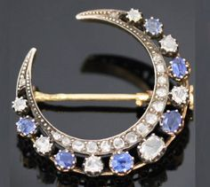 Crescent brooch with sapphires and diamonds