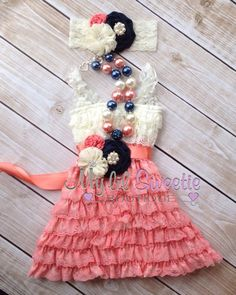 Coral, navy and ivory flower girl dress - see more info at http://themerrybride.org/2014/11/24/coral-and-navy-wedding-2/