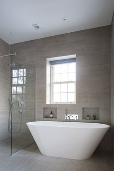 Keeping things neutral to allow this gorgeous freestanding bath to take all of the limelight in this amazing bathroom. Tiles supplied by us, TBK Tiles. Amazing Bathrooms, All Design, Freestanding Bath, Tiles, Neutral, Bathtub, Bathroom Bath, Bath Shower, Bathroom Ideas