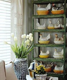 Love this collection of chickens in a basket!  And the chicken wire on the cupboard is perfect! ♥