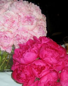 These are two cube vase floral arrangements each consisting of peonies in a pale pink and magenta color scheme.  See our entire selection at www.starflor.com.  To purchase any of our floral selections, as gifts or décor, please call us at 800.520.8999 or visit our e-commerce portal at www.Starbrightnyc.com.  This composition of flowers is generally available for same day delivery in New York City (NYC). SQ001