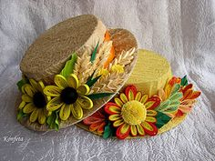 beautiful quilled flowers on hats - by artist shown on photo.