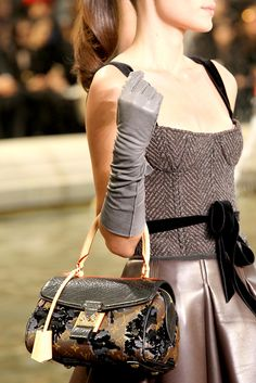 TDF! Details shot Louis Vuitton Fall 2010. Shimmery skirt with tweed corset top, velvet ribbon details and gorgeous handbag.