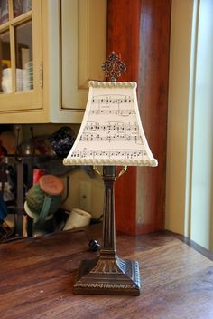 By far the coolest re-purposing ever - vintage sheet music performs beautifully as an elegant shade.