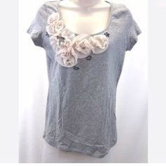 Talbots gray flower t shirt NWT XS Talbots women's t-shirt Size XS Light gray color with light pink flower and beaded design 100% Pima cotton SUPER SOFT! Decoration is 100% Polyester Measures approximately: Bust 35 inches, waist 32 inches, shoulders 13.5 inches, sleeves 5.5 inches, length 24.25 inches New with tags condition. No visible defects other than the manufacturer tag is detached on one side. Original retail $54.50  #705-11 Talbots Tops Tees - Short Sleeve