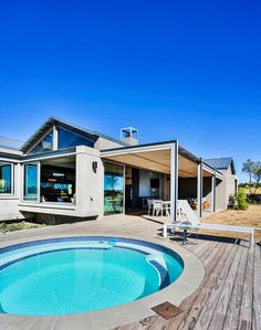Our modern established farm house boasts solid concrete structures that arrest the visitor on arrival providing framed views of the hills in the background. Modern Pools, Concrete Structure, Outdoor Spaces, Outdoor Decor, Open Plan Living, Pool Designs, Ponds, Water Features, Modern Farmhouse