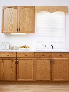 Slide show of ways to redecorate a kitchen with plain builder's grade cabinets by various paint and detail options.