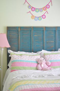 Love the idea of the reclaimed shutter as a headboard.