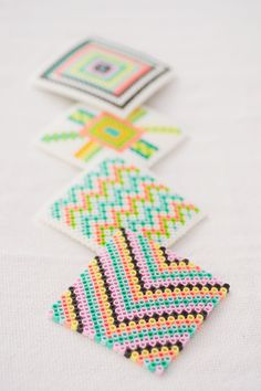 DIY Geometric Fused Bead Coasters. I totally thought I was over these beads, but this is too cute! Instead of coasters, maybe some sort of patchwork wall art?