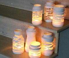 yarn wrapped painted jars- Wrap some yarn or twine around a jar, paint it, and peel the yarn away once it's dry: you'll be left with a gorgeous luminary for tea lights or candles Candle Lanterns, Candles, Deco Table Noel, Glass Jars, Diy Gifts, Diy Wedding, Christmas Diy, Diy And Crafts, Diys