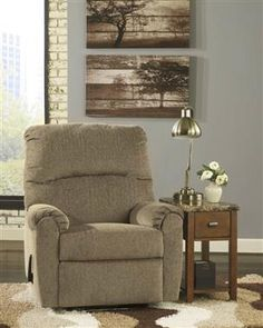 The Pranit Zero Wall Recliner From Ashley Furniture Features A Cushioned  Cored Made Of High Quality Foam Supporting A Rich Cork Tone Polyester  Upholstery.