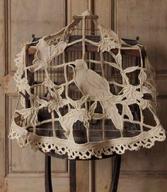 This beautiful lace cutwork piece is a bird cage cover....