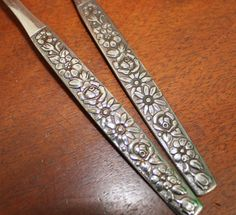 Floral accents with a mid century vibe. PIECES: 1 slotted spoon 1 serving fork Stainless steel workhorses will go from the table to the dishwasher in a breeze and be ready to go again the next day. These pieces can be used for formal occasions that call for some bling, or for those