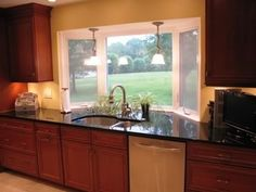 Mini bay window over the kitchen sink with shelving...a \