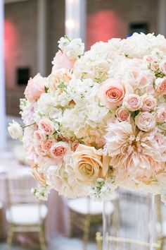 Gorgeous blush color wedding centerpiece idea; click to see more gorgeous details of this wedding. photo: Jasmine Lee