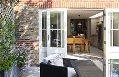 Credit: Sophia Evans/Sophia Evans The Kellows didn't want the garden to feel like a seamless extension of the kitchen, so there's a small step between the two, and french windows rather than sliding doors.