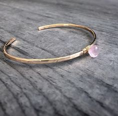A personal favorite from my Etsy shop https://www.etsy.com/listing/227853458/genuine-rose-quartz-cuff-bracelet-14k