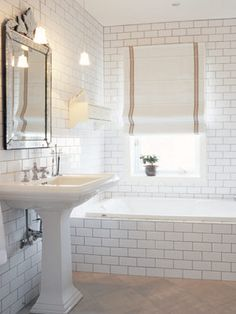 love the subway tiles in this bathroom