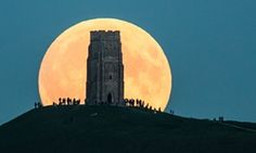 Glastonbury Tor, Glastonbury, England. Super moon and lunar eclipse combine for 'blood moon'. Pictures from around the world on the Guardian.