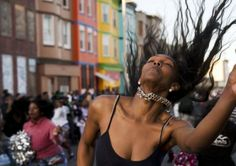 rotesters dance on 28 April in Baltimore Photograph: Matt Rourke/AP