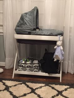 Renner's nursery. Uppababy bassinet stand. Love the ability to move the bassinet from the stand to the stroller with ease. It also changes into a hamper using the inserts when we transition Renner to his crib.