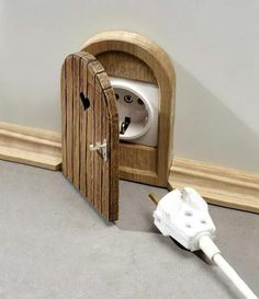 How adorable!  Make a little door to cover an outlet!  You could do this in the middle of a wall to to child proof a room!
